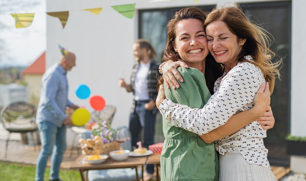 Two women embracing at a birthday party